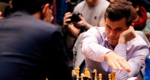 Norway's Magnus Carlsen hits the clock as he plays in the tie-break matches of the 2018 World Chess Championship against Fabiano Caruana  in London. Photograph: Getty Images