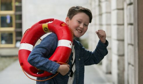 LIFESAVER: Finn Bell Ryan (8) from Limerick who recieved a Seiko Just in Time Award for rescuing a 3-year-old boy from a swimming pool in Portugal during Irish Water Safety's annual awards ceremony at the Hibernia Conference Centre at Dublin Castle Photograph: Gareth Chaney/Collins
