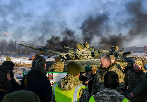 DRILLS: Ukrainian president Petro Poroshenko speaks with tankmen during drills near the city of Chernihiv in northern Ukraine. Mr Poroshenko has imposed martial law from November 28th for 30 days in 10 regions bordering Russia, the Black Sea and the Azov Sea. Photograph: Mykola Lazarenko/Ukranian Presidential Press Service/AFP/Getty