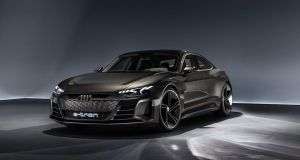 Audi has used the Los Angeles motor show to reveal its much-teased electric four-door coupe, the e-Tron GT