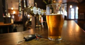One pint of beer or one glass of wine 'could put you over the limit'. File photograph: Philip Toscano/PA Wire