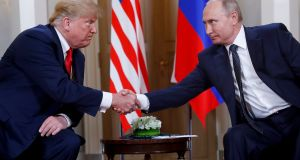 File photo:  US president Donald Trump, (left) shakes hands with Russian resident Vladimir Putin, at their previous formal sit-down meeting in Helsinki, Finland taken on July 16th, 2018  Photograph: Pablo Martinez Monsivais/AP/ File