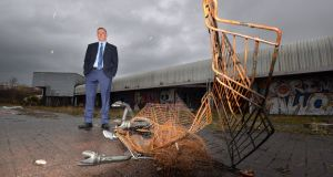 Dr Conor Patterson, chief executive of the Newry and Mourne Co-operative and Enterprise Agency at the defunct former customs clearance facility on the outskirts of Newry.  Photograph: Alan Betson