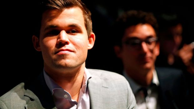 Magnus Carlsen with his challenger Fabiano Caruana. Photograph: Tolga Akmen /AFP/Getty Images