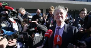 Peter Casey arrives at Dublin Castle the day after the election. He is now picking up the Newstalk microphone. Photograph: Nick Bradshaw/The Irish Times
