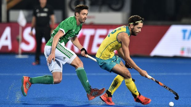 Ireland's Chris Cargo tries to close down Australia's Flynn Ogilvie during his side's 2-1 defeat. Photograph: Charles McQuillan/Getty