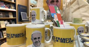 Pope Francis mugs among some of the range of Pope Francis memorabilia and souvenirs on sale at Veritas  earlier this year . Photograph: Bryan O'Brien / The Irish Times