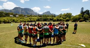 The Connacht squad in a huddle during training at Wynberg Boys High School, Cape Town, as they prepare for the game against the Cheetahs. Photograph: James Crombie/Inpho