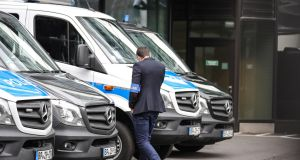 German police vehicles parked outside Deutsche Bank's headquarters Frankfurt.