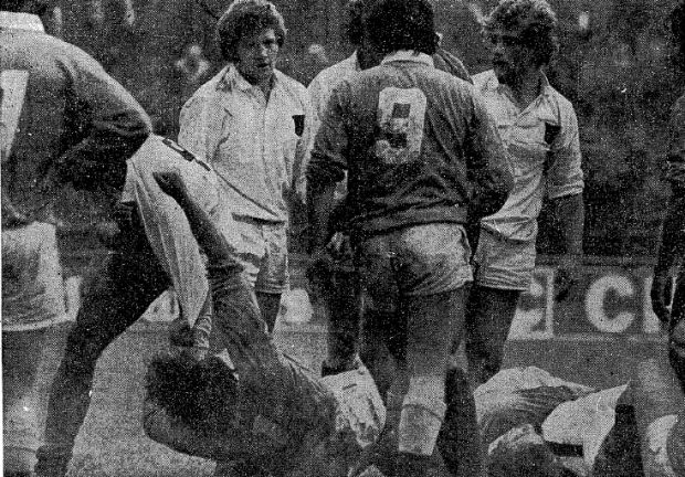 Michael Gibson of Trinity (white shirt) exchanges punches with UCD prop Tom Kavanagh (on ground) during the 1977 colours match. Photo: Peter Thursfield/The Irish Times