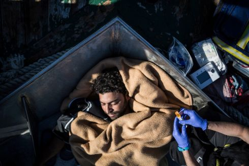 A sick migrant from Egypt is given medical treatment on the deck of the Nuestra Madre de Loreto Spanish fishing vessel carrying 12 migrants rescued off the coast of Lybia on Friday. Photograph: Javier Fergo