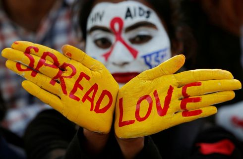 A student's face and hands painted with messages during an HIV/Aids  awareness campaign on the eve of World Aids Day in Chandigarh, India. Photograph: Ajay Verma
