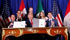US president Donald Trump,  with Canada's prime minister Justin Trudeau (right)  and Mexico's president Enrique Pena Nieto at the USMCA signing ceremony before the G20 summit in Buenos Aires. Photograph: Kevin Lamarque