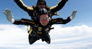 Former US president George HW Bush (bottom) celebrates his 85th birthday by jumping with the US army's Golden Knight parachute team in a tandem jump with SFC Michael Elliott in Kennebunkport, Maine in  2009. Photograph: Reuters