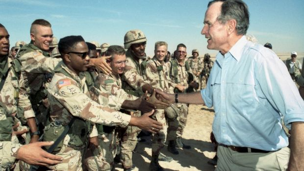The then US president George HW Bush greets American troops in Saudi Arabia weeks before the start of the Gulf war in 1991. Photograph: The New York Times