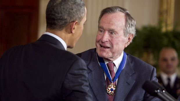 Former US president George HW Bush is awarded the Presidential Medal of Freedom from US President Barack Obama at the White House in Washington in 2011. Photograph: Bloomberg