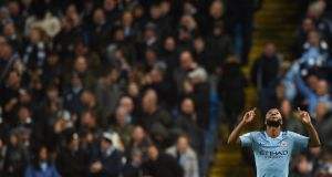 Manchester City's   Raheem Sterling celebrates scoring their second goal. Photograph: Getty Images