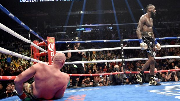 Tyson Fury on the canvas during his clash with Deontay Wilder in LA. Photograph: Lionel Hahn/PA