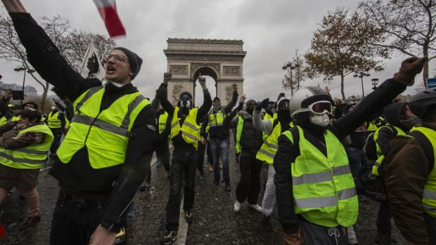 Protesters at a 'yellow vest' demonstration near the Arc de Triomphe. Photograph: Getty