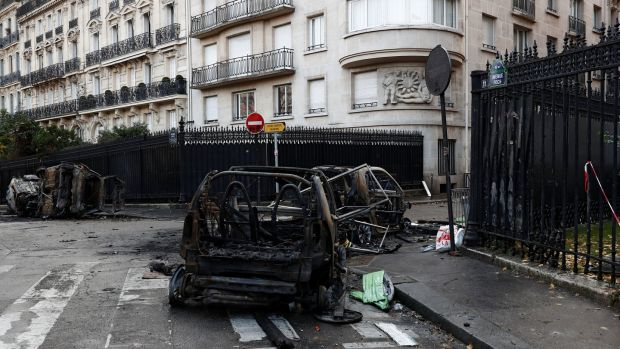 Destroyed cars on the morning after clashes with protesters against fuel tax rises, in Paris, France. Photograph: Benoit Tessier/Reuters