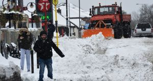 A Snow Plough clearing main street Clonee, Co Meath, during the snowfall associated with Storm Emma the The Beast from the East. Photograph: Alan Betson