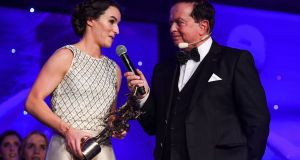 Sinéad Aherne of Dublin speaking with MC Marty Morrissey after winning the TG4 Senior Players' Player of the Year Award  during the TG4 Ladies Football All Stars Awards  at the Citywest Hotel in Dublin. Photograph:  Brendan Moran/Sportsfile