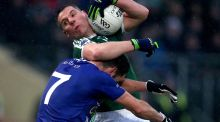 Gaoth Dobhair's Kevin Cassidy is tackled by Scotstown's Emmet Caulfield during the Ulster club football final at Healy Park. Photograph: Bryan Keane/Inpho