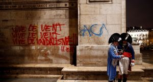 Graffiti  on a  wall at the Arc de Triomphe in Paris on the day after serious clashes with yellow vest protesters. Photograph: Stephane Mahe/Reuters