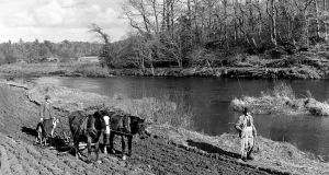 A successful angler passes a ploughman near Macroom in 1953. One of the illlustrations from 'Salmon on the River Lee'