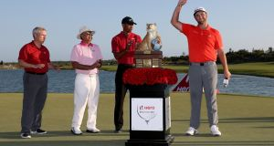 Jon Rahm of Spain poses with the trophy after winning the Hero World Challenge at Albany, Bahamas. Photograph: Rob Carr/Getty Images
