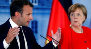 Earlier in the year Emmanuel Macron announced a €1.5 billion investment in AI in France and last week Angela Merkel announced a €3 billion investment in AI in Germany. Photograph: Reuters/Hannibal Hanschke