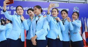 "Volunteers take selfies after the UN World Geospatial Information Congress in China: ""algorithms will increasingly be used to determine the distribution of important social goods, including work, loans, housing and insurance"". Photograph: Zhejiang Daily/VCG via Getty"