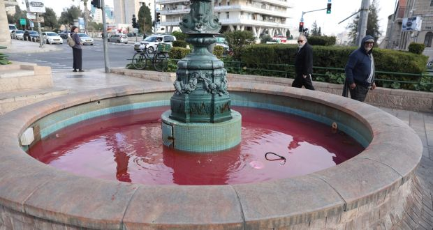 The fountain in France (Paris) Square in Jerusalem is turned red by activists as part of a violence against women national protest in  Israel. Photograph: Abir Sultan/EPA
