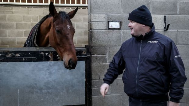 Gordon Elliott with Envoi Allen at his yard in Longwood, Co Meath, on Monday. Photograph: Dan Sheridan/Inpho