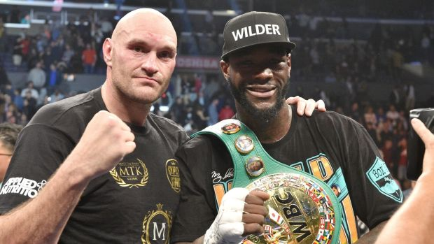 Deontay Wilder and Tyson Fury after their epic in LA. Photograph: Lionel Hahn/PA