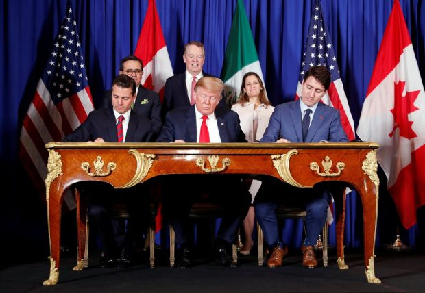 US president Donald Trump, Canada's prime minister Justin Trudeau and Mexico's president Enrique Pena Nieto, sign documents during the USMCA signing ceremony before the G20 leaders summit in Buenos Aires on November 30th Photograph: Kevin Lamarque/Reuters