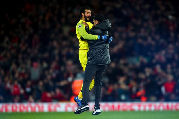 Klopp celebrates with Liverpool goalkeeper Alisson Becker after Divock Origi's 96th minute winning-goal against Everton on December 2nd Photograph: Robbie Jay Barratt/AMA/Getty