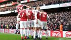 Arsenal players celebrate Pierre-Emerick Aubameyang's goal against Tottenham at Emirates Stadium on Sunday,  as a banana skin is thrown onto the pitch.  Photograph: Nick Potts/PA Wire