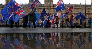 Pro-European Union (EU), anti-Brexit demonstrators wave Union and EU flags as they protest opposite the Houses of Parliament in London on December 3, 2018. Photograph: DANIEL LEAL-OLIVAS/AFP/Getty Images