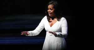 Michelle Obama acknowledges the crowd at the Royal Festival Hall in London on Monday. Photograph:  Yui Mok/PA