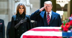 US president Donald Trump and his wife Melania pay respects to former president George HW Bush as he lies in state in the Rotunda of the US Capitol in Washington on Monday. Photograph: Jim Lo Scalzo/EPA