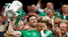 Limerick's Seamus Hickey lifts the Liam MacCarthy Cup. Photograph: James Crombie/Inpho