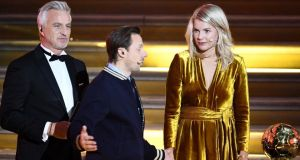 Ballon d'Or: Ada Hegerberg on stage with Martin Solveig and (left) David Ginola.  Photograph: Franck Fife/AFP/Getty