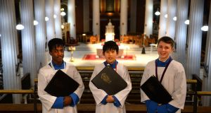 Conor McGloughlin, Chanchan Yubozhou and Cameron Drumm, of The Palestrina Choir of St Mary's Pro Cathedral, Dublin. Photograph: Dara Mac Dónaill