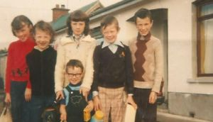 Anthony J Quinn and his siblings as children. Quinn is the tallest of the boys(far right), followed by Jim, and then Paul, who both feature in the essay