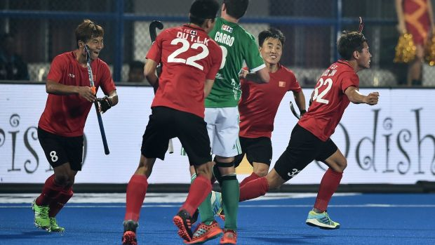 China celebrate Guo Jin's opener against Ireland. Photograph: Charles McQuillan/Getty