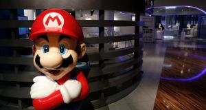 In the late 1980s, Nintendo developed a games console that changed the gaming world forever with games such as Super Mario. Photograph: Kiyoshi Ota/EPA