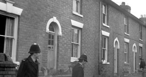 Policemen outside a house in Gillam Street, Worcester, where the bodies of three young children were found impaled on garden railings in April 1973. File photograph: PA