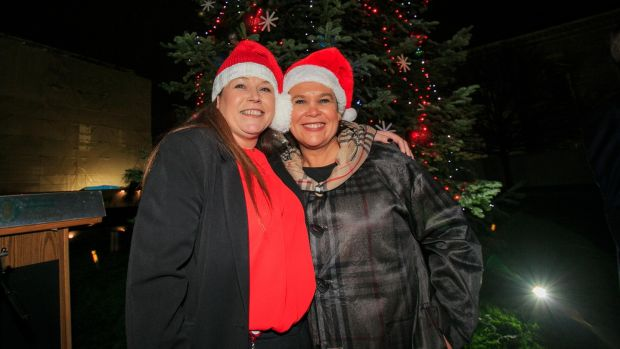 Sinn Féin TD Louise O Reilly (left) and party president Mary Lou McDonald TD during a turning on for the Oireachtas Christmas tree lights at Leinster House, Dublin Photograph: Gareth Chaney/Collins