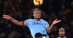 Manchester City's Vincent Kompany in action at Vicarage Road last night. Photograph: Getty Images